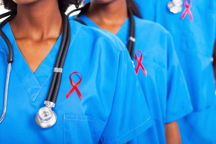 african medical doctors with red ribbon