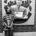 Local Artist Ras 'Ammar Nsoroma helps dedicate portrait of local health advocate at MHS grand re-opening