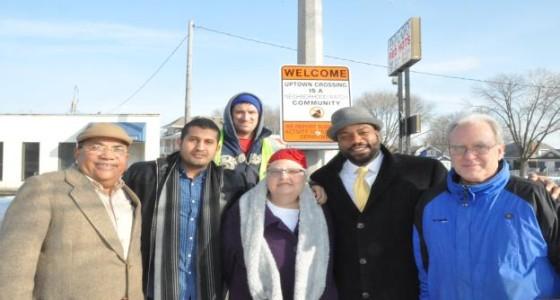 Uptown Crossing installs final Neighborhood Watch sign
