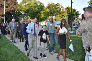 Gov. Scott Walker, Milwaukee Mayor Tom Barrett, State Rep. Mandela Barnes and Ald. Ashanti Hamilton joined members of the Milwaukee Board of School Directors and students on their way to their first day of classes.